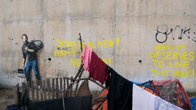 the son of a migrant from Syria // Calais - dec 2015 © Banksy