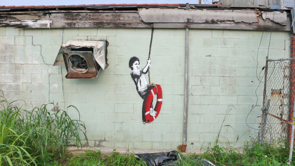 banksy - street art - graffiti - new orleans - kid on ring