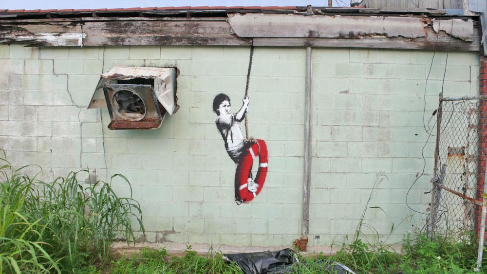 banksy - street art - graffiti - new orleans - kid on ring