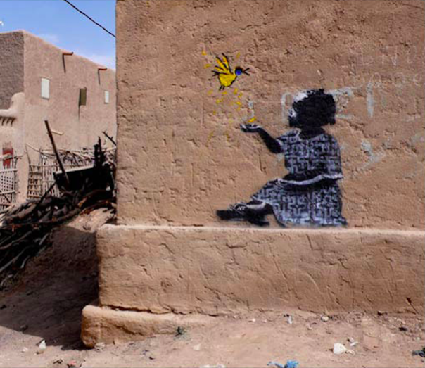 banksy - street art - graffiti - mali - girl bird